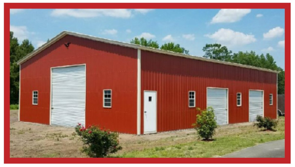 Commercial grade red metal garage with 3 garage doors